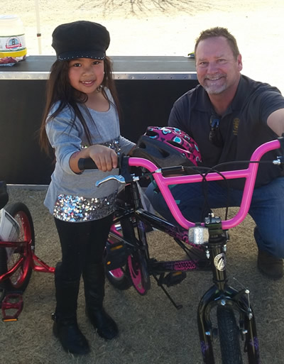 ParkFest at Paseo Verde Park. Councilmember Finn with a winner of the bicycle raffle.