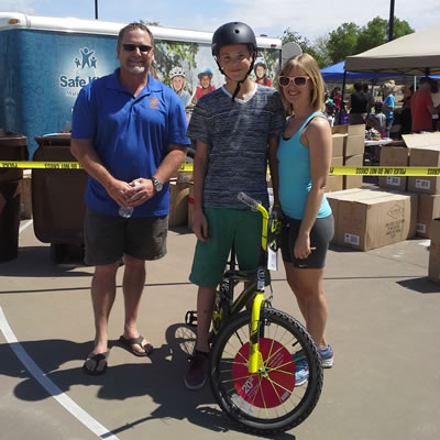 Parkfest at Sweetwater Park. Councilmember Finn with one or the winners of the bicycle raffle.