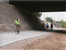 Cyclists and pedestrians enjoying the Skunk Creek mixed use trail in Peoria AZ